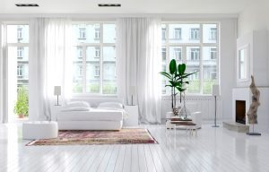 Clean Home with white walls, plants, and fireplace in the city